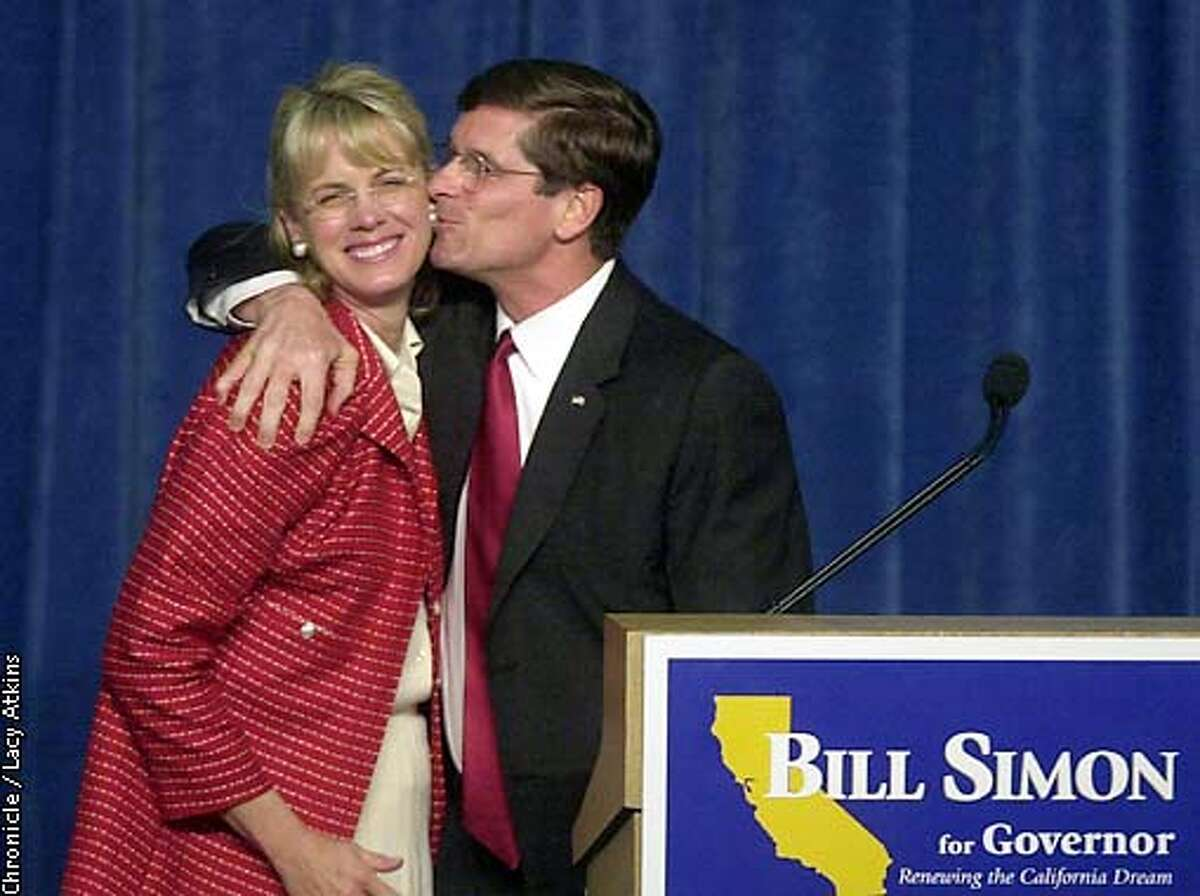 GOVELECT8-05MAR02-MN-LA Republican Govenor canidate Bill Simon gives his wife Cindy a kiss as he thanks her for her help in the election at his victory speech. PHOTO BY LACY ATKINS/CHRONICLE