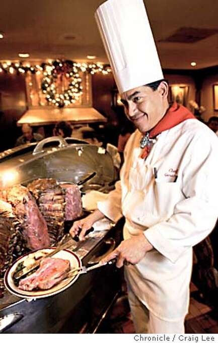 Story about how to cook prime rib. Photo of chef Gerardo Ramirez at the House of Prime Rib restaurant in San Francisco on Van Ness Avenue, carving up a piece of prime rib. Event on 12/8/03 in San Francisco.  CRAIG LEE / The Chronicle Photo: CRAIG LEE