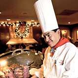 Story about how to cook prime rib. Photo of chef Gerardo Ramirez at the House of Prime Rib restaurant in San Francisco on Van Ness Avenue, carving up a piece of prime rib. Event on 12/8/03 in San Francisco.  CRAIG LEE / The Chronicle