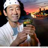 Chef-owner Sachio Kojima shows a special Scott handroll. Chronicle photo by Scott Sommerdorf