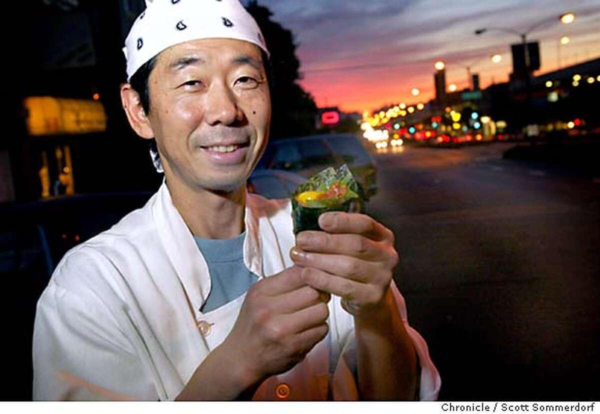 Chef-owner Sachio Kojima shows a special Scott handroll. Chronicle photo by Scott Sommerdorf