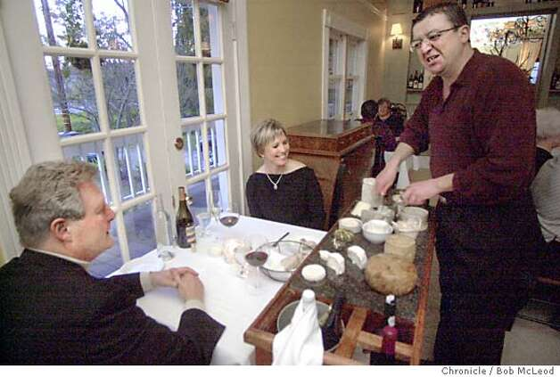 D23FARM-C-06MAR03-MG-BM manager joseph Bain (far right, standing) shows the cheese cart to John and Wynne Bergman at the Farmhouse Inn in Forestville.  chronicle photo by Bob McLeod Photo: PENNI GLADSTONE