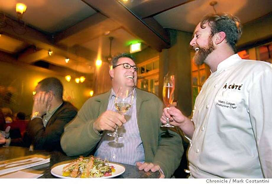 chefsnightout25_0015.JPG Photo taken on 1/14/04 in Oakland.  Chef Kimball Jones(left), dining at A Cote restaurant, has a drink with, jokes around with and talks shop with A Cote's executive cheff Matt Golgan(right).  CHRONICLE PHOTO BY MARK COSTANTINI Kimball Jones, corporate chef for Wente Vineyards, raises a glass with A Cote executive chef Matt Golgan. ProductName	SundayDatebook Photo: MARK COSTANTINI