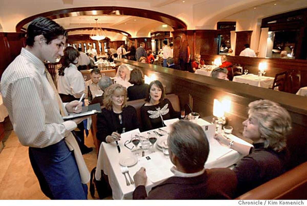 Poggio, the latest restaurant opened by Il Fornaio founder Larry Mindel, opens in Sausalito. Seated, clockwise Susan Rowe, Beth Martin Marci Yenerich and Thomas Clark place their orders with waiter KIM KOMENICH/The Chronicle