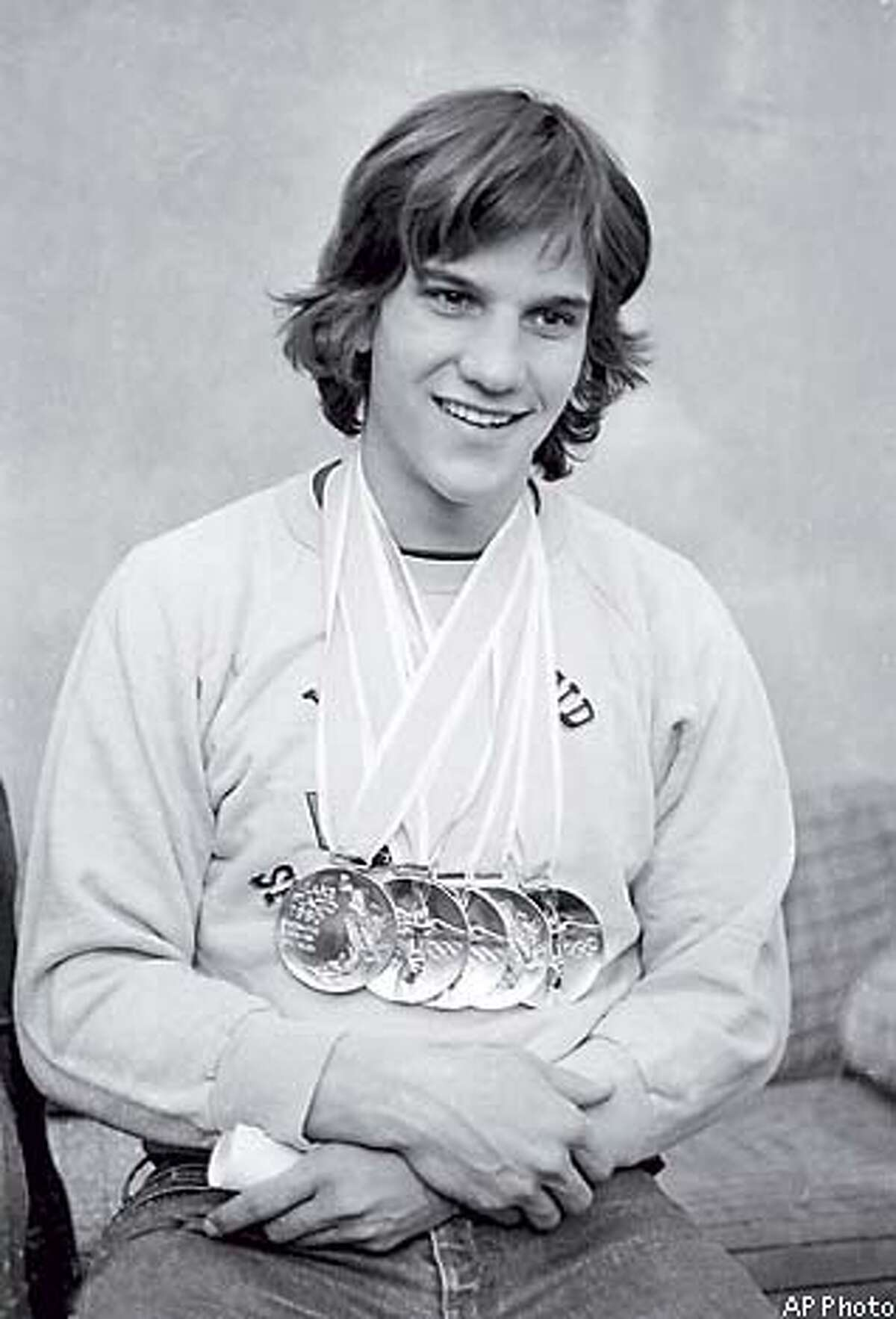 Gold standard: Heiden displays the five gold medals he won in speed skating during the 1980 Winter Olympics in Lake Placid, N.Y. Associated Press Photo, 1980