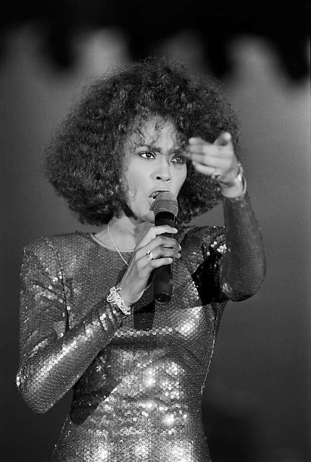 A file picture taken on July 03, 1988 in Monaco shows US singer Whitney Houston performing at the Monte Carlo Sporting Club. Grammy-winning pop legend and actress Whitney Houston, 48, was found dead on February 11, 2012 in a Beverly Hills hotel, police said. Photo: Christophe Simon, AFP/Getty Images