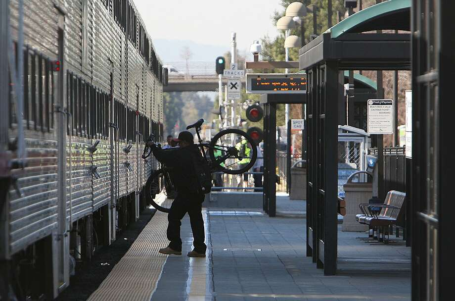 A passenger boards a northbound Caltrain at the station in Mountain View, Calif., on Thursday, February 9, 2012.  Caltrain between San Francisco to San Jose is seeing electrified trains as a potential to the commuter rail line. Photo: Liz Hafalia, The Chronicle