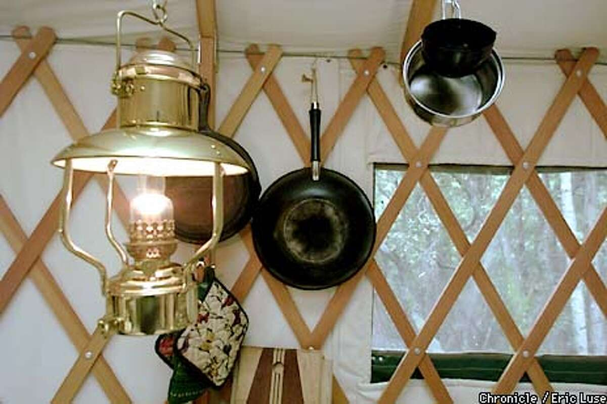 Jen Cote and Derek(cq) Harwell uses lanterns for light in their Yurt. BY ERIC LUSE/THE CHRONICLE