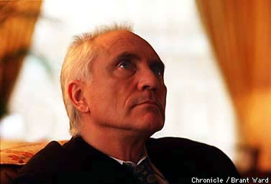 """STAMP/20FEB98/DD/WARD--Actor Terence Stamp has a new film called """"Love Walked In."""" Here he catches a glimpse at the Clift Hotel. By Brant Ward/Chronicle"""