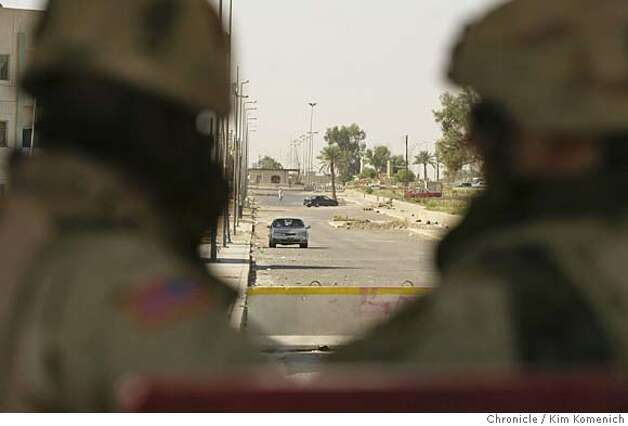 In Tikrit, Iraq, soldiers at Camp Danger's Horse Gate look at a suspicious car. It was determined that the driver was ok. A visit to the heavily guarded South Gate and Horse Gate entrances to the Camp Danger. There have been several attempted suicide bombings here. We speak with members of C Battery, 3rd Battalionof the 133rd Artillery, who chased a would-be bomber from South Gate a few weeks ago.  San Francisco Chronicle photo by Kim Komenich Photo: Kim Komenich
