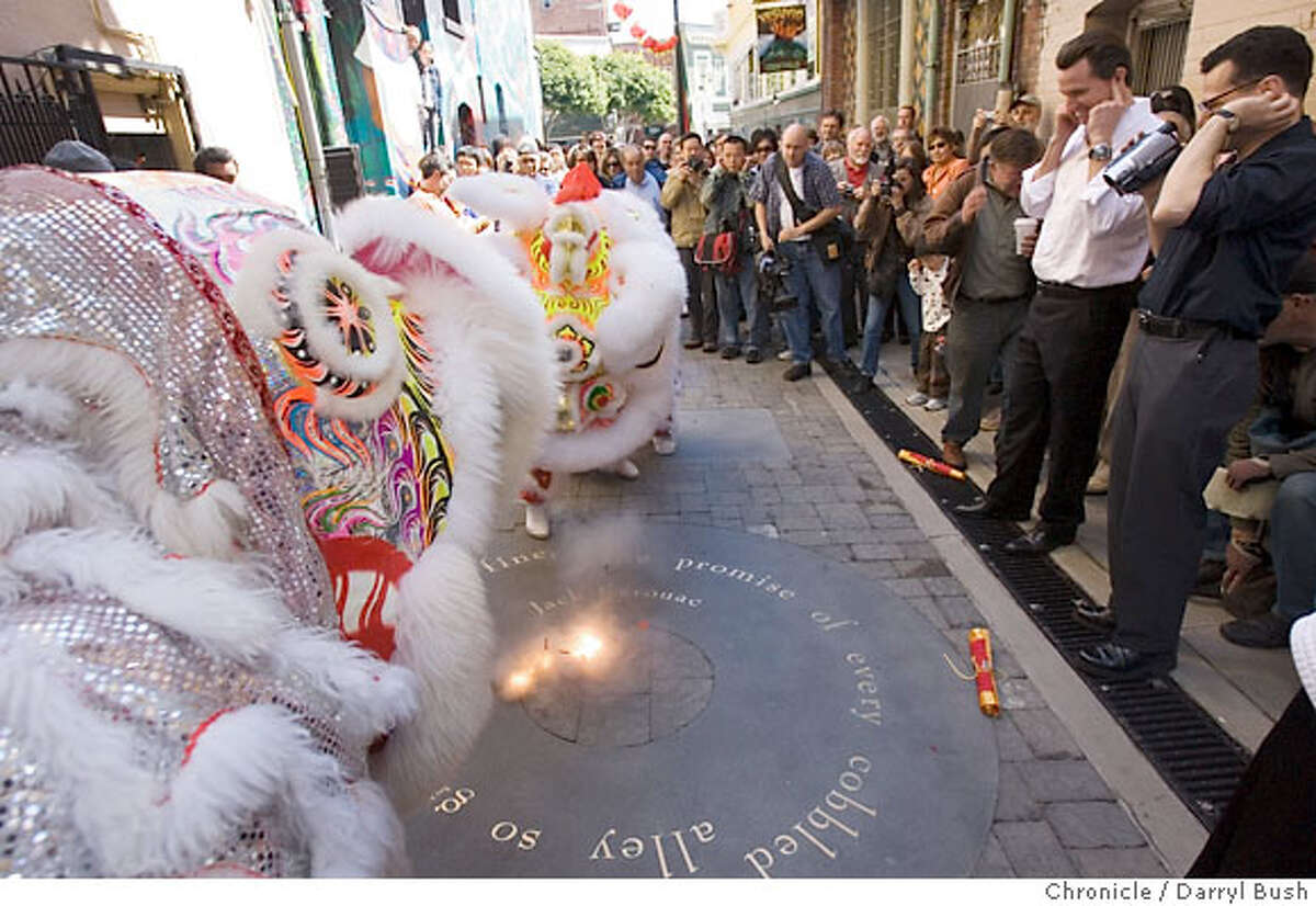 Lion Dancers dance near the lighting of the firecrackers going off in the middle of Jack Kerouac Alley with Mayor Gavin Newsom plugging his ears at 2nd from right as a crowd of hundreds attend the Jack Kerouac Alley Dedication for the newly restored Jack Kerouac Alley between Grant and Coumbus in North Beach, which was attended by community leaders and local residents from North Beach and Chinatown and included entertainment and festivities from 12:00 to 4:00 p.m. in San Francisco, CA, on Saturday, March, 31, 2007. photo taken: 3/31/07 Darryl Bush / The Chronicle ** Gavin Newsom (cq)