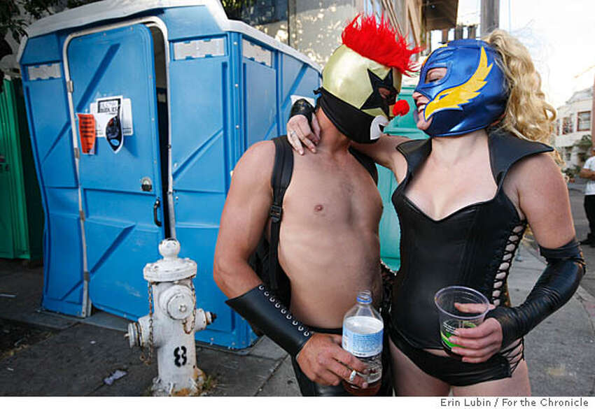 Mark Hanley, left, and Sage Travigne, right, share a moment together during the Folsom Street Fair in San Francisco, CA Sunday, September 30, 2007.