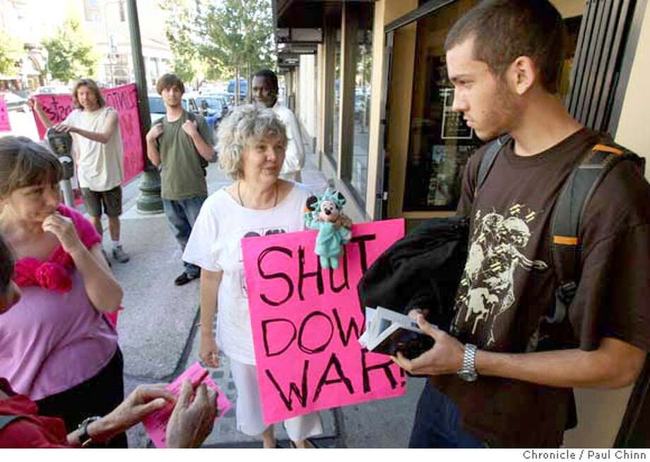 Phoebe Sorgen (center), a demonstrator with Code Pink, tries to convince 17-year-old David Felkins (right) from enlisting in the military after he visited the Marine Corps recruiting office in Berkeley, Calif. on Wednesday, Oct. 3, 2007. PAUL CHINN/The Chronicle  **Phoebe Sorgen, David Felkins MANDATORY CREDIT FOR PHOTOGRAPHER AND S.F. CHRONICLE/NO SALES - MAGS OUT Photo: PAUL CHINN