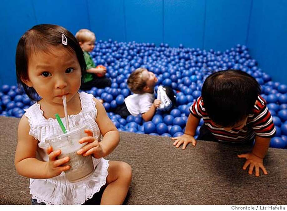 PLAYCAFE12_112_LH_.JPG Sydney Chien, 18 mos. old, from Hercules having a super kid's smoothie at Play Cafe--4400 Keller Ave., Oakland--a locally owned cafe where parents can bring their children to play. In back, left to right, is Henry Rottinghaus, 2 years old, from El Cerrito, Logan Catz, 2 years old, from Oakland, and Noah Bauer, 19 mos. old, from Danville  Liz Hafalia/The Chronicle/Oakland/9/6/07  **Sydney Chien, Henry Rottinghaus, Logan Catz, Noah Bauer cq �2007, San Francisco Chronicle/ Liz Hafalia  MANDATORY CREDIT FOR PHOTOG AND SAN FRANCISCO CHRONICLE. NO SALES- MAGS OUT. Photo: Liz Hafalia