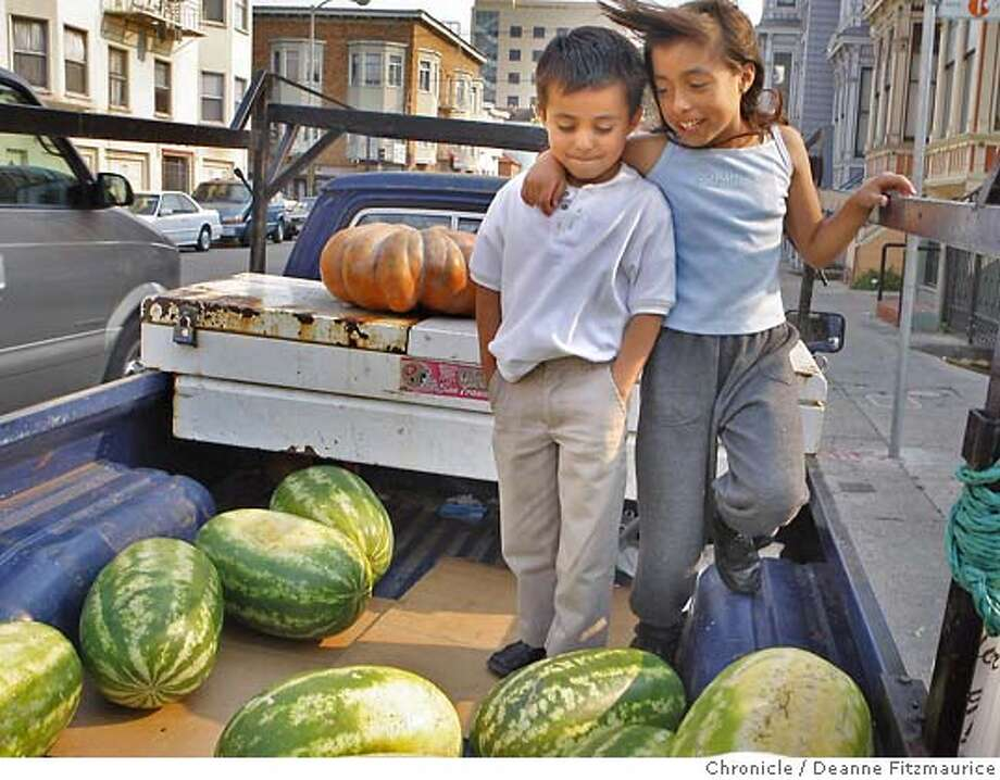 place11_069_df.jpg  At 24th and Capp Streets, Kimberly Garcia, 9, puts her arm around her brother Andrew, 6, as they wait for their uncle, Hugo Garcia to unload watermelons he is selling. 24th Street spans from the Mission District to Noe Valley. Photographed in San Francisco on 9/6/07. Deanne Fitzmaurice / The Chronicle Photo: Deanne Fitzmaurice