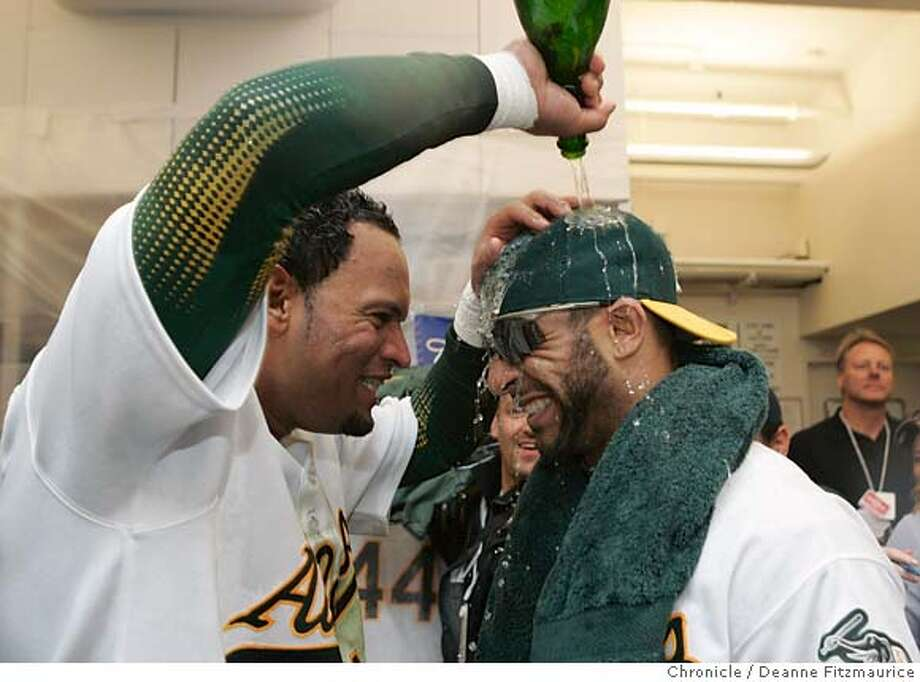 D'Angelo Jimenez pours champagne on Jay Payton in the locker room after the Oakland Athletics beat the Minnesota Twins 8-3 and advanced to the American League Championship Series. The Oakland Athletics play the Minnesota Twins in game three of the American League Divisional Series. Event on Friday, October 6, 2006 at McAfee Stadium in Oakland, California. Deanne Fitzmaurice / The Chronicle Photo: Deanne Fitzmaurice