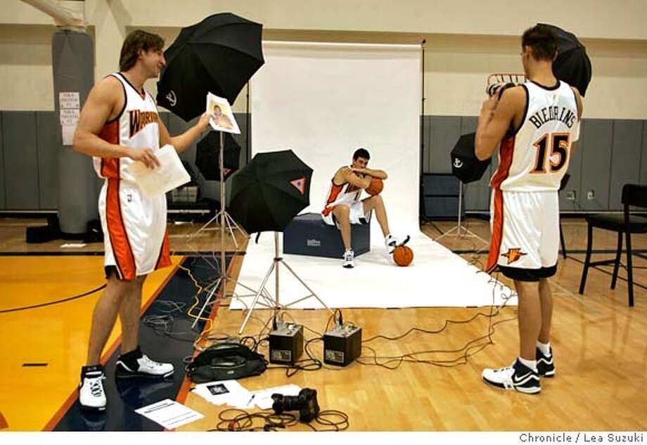 warriors_001_ls.JPG  From left: Troy Murphy, Zarko Cabarkapa, Andris Biedrins. Biedrins takes a turn with the Warriors team photographer's (Rocky Widner)camera while Cabarkapa sits for photos.  Media day for Warriors at the Warriors practice facility at their headquarters in Oakland on October 2, 2006, Monday.  Photo by Lea Suzuki/The San Francisco Chronicle  Photo taken on 10/2/06, in Oakland, CA. **(roster) cq. MANDATORY CREDIT FOR PHOTOG AND SAN FRANCISCO CHRONICLE/ -MAGS OUT Photo: Lea Suzuki