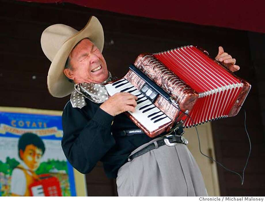 Sourdough Slim, the yodeling, accordian playing cowboy entertains the crowd.  Accordion aficionados gathered in Cotati over the weekend for the 17th-annual music fest at La Plaza Park. His real name is Rick Crowder.  Photo taken on 8/26/07 in Cotati, CA  Photo by Michael Maloney / San Francisco Chronicle  ***Rick Crowder MANDATORY CREDIT FOR PHOTOG AND SF CHRONICLE/NO SALES-MAGS OUT Photo: Michael Maloney