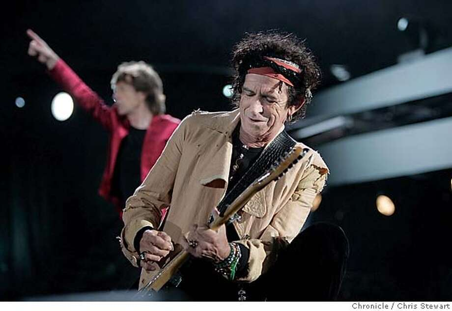 """The Rolling Stones Keith Richards (front), joins mates Mick Jagger (rear), Ron Wood and Charlie Watts (not pictured), as they play """"Jumping Jack Flash"""" at McAfee Coliseum in Oakland on their """"A Bigger Bang"""" tour tonight, November 6, 2006. Chris Stewart / The Chronicle Photo: Chris Stewart"""