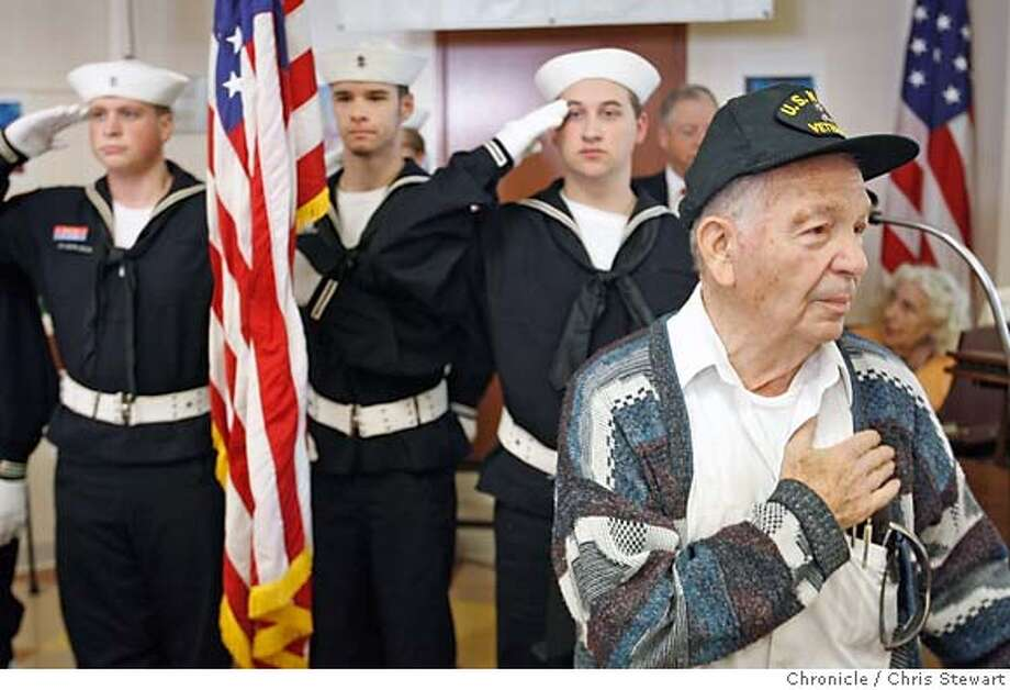 VETERANS_FEATURE_0017_cs.jpg  Peter Bisacca, 83, a former Gunner's Mate Third Class in the U.S. Navy, says the Pledge of Allegiance near members of a local teen scouting troop from the Sea Scout Ship Gryphon of Redwood City at the beginning of a special lunch held today November 10, 2006, to honor military veterans of foreign wars, including World War II, the Korean War, and the Vietnam War at Avenidas Center, a senior day care center in Palo Alto. Sea Scouts are Jacob Luras (left), 17, Nick Perrone (holding flag), 17, and Nick Crowley, 17. Not visible are fellow scouts Will Larsen, 15, and Ben Southgate, 16, and their skipper, Mike Marzano. A handful of retired military men and women joined the regular seniors for the lunch. The lunch also included the Pledge of Allegiance and a patriotic songs sing-along. For further information contact Kari Martell, Avenidas, (650) 289-5427 or Patricia Nevius, 650-289-5428  Chris Stewart / The Chronicle Veterans MANDATORY CREDIT FOR PHOTOG AND SF CHRONICLE/ -MAGS OUT Photo: Chris Stewart