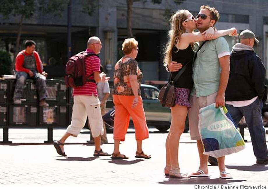 niners_0154_df.jpg  Natalie Osadciw (cq), 21, kisses her boyfriend, Paul Louth, 21 at Market and Powell Street on a warm day in San Francisco. They are from Birmingham, England and are on a 4 month tour around the world. Photographed in San Francisco on 9/12/06.  (Deanne Fitzmaurice/ The Chronicle)  Natalie Osadciw Paul Louth Mandatory credit for photographer and San Francisco Chronicle. /Magazines out. Photo: Deanne Fitzmaurice