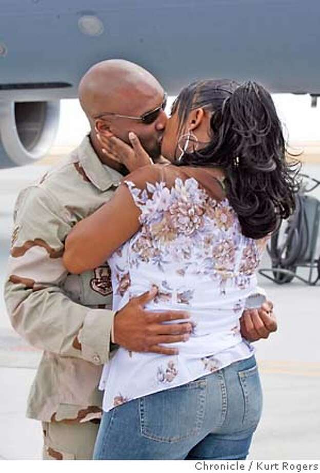 Adeyam Parker (cq) who proposed to Kristin Harrison the minut he saw her and she said yes.  Air Force airmen stationed at Travis AFB return after several months in Iraq.  KURT ROGERS/THE CHRONICLE VACAVILLE THE CHRONICLE  SFC RETURN_0176_kr.jpg MANDATORY CREDIT FOR PHOTOG AND SF CHRONICLE / -MAGS OUT Photo: KURT ROGERS/THE CHRONICLE