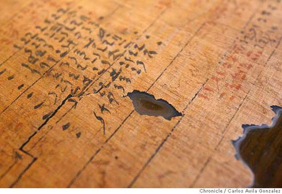 PAPYRI02_005_CAG.JPG  A portion of one of the Reisner scrolls. UC Berkeley announces it has acquired a new batch of ancient Egyptian scrolls -- said to be among the most signicant administrative documents of the Middle Kingdom (2,000 BCE). The scrolls were found by archaeologist George Reisner from 1901-04 but had been secreted in Europe and Boston before finally making their way to UCB's Bancroft Library.  Photo by Carlos Avila Gonzalez/The San Francisco Chronicle  Photo taken on 11/1/06, in Berkeley, Ca, USA  **All names cq (source) MANDATORY CREDIT FOR PHOTOG AND SAN FRANCISCO CHRONICLE/ -MAGS OUT Photo: Carlos Avila Gonzalez