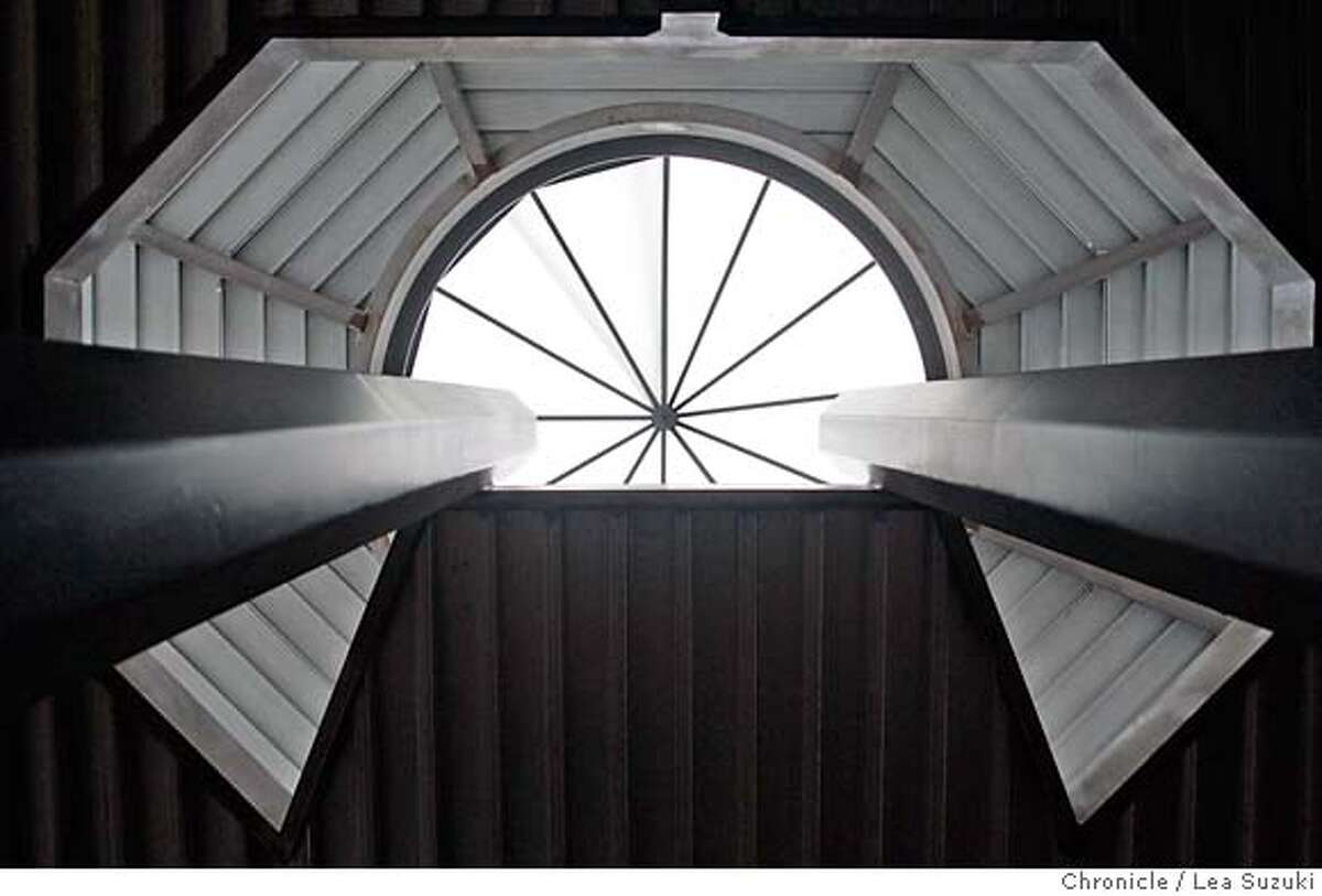 sigstyle_thorne_070_ls.JPG The skylight of the Millennium house, which is currently under construction in the Oakland Hills by Ed Baker at 6335 Skyline Blvd on Wednesday, October 4, 2006, seen through an opening for an elongated spiral staircase. The beams on either side are a stretched octagonal shape which will match the shape of the living room. Photo by Lea Suzuki/The San Francisco Chronicle Photo taken on 10/4/06, in Oakland, CA. Story for the Signature Style series. We study the homes of Beverly Thorne, a local architect known for using structural strength for both strength and aesthetics. **(themselves) cq. MANDATORY CREDIT FOR PHOTOG AND SAN FRANCISCO CHRONICLE/ -MAGS OUT