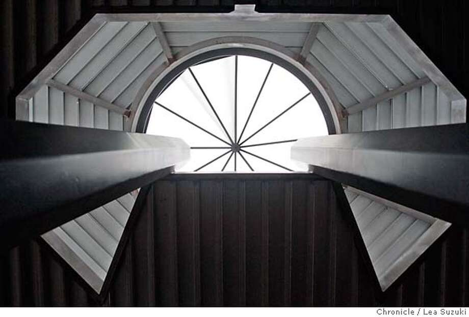 sigstyle_thorne_070_ls.JPG  The skylight of the Millennium house, which is currently under construction in the Oakland Hills by Ed Baker at 6335 Skyline Blvd on Wednesday, October 4, 2006, seen through an opening for an elongated spiral staircase. The beams on either side are a stretched octagonal shape which will match the shape of the living room.  Photo by Lea Suzuki/The San Francisco Chronicle  Photo taken on 10/4/06, in Oakland, CA. Story for the Signature Style series. We study the homes of Beverly Thorne, a local architect known for using structural strength for both strength and aesthetics. **(themselves) cq. MANDATORY CREDIT FOR PHOTOG AND SAN FRANCISCO CHRONICLE/ -MAGS OUT Photo: Lea Suzuki