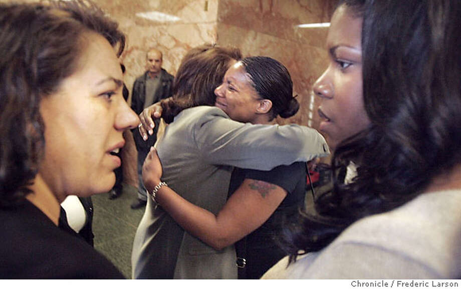 Sheena Young, center, and her sister Shonna Hall (right) embraced relatives of Omeed Ariz Popal after the arraigned at the Hall of Justice. Relatives of the suspect and victim of Leon Stevens who was hit and injured at Stenier Street in San Francisco consoled each other outside the court room. No names where given of the relatives of the suspect. **Omeed Ariz Popal, Sheena Young (black shirt), Shonna Hall (tall)  9/6/06  {Frederic Larson/The Chronicle } Photo: Frederic Larson