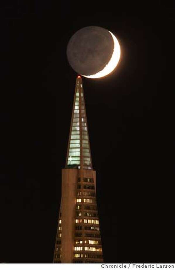 It was one of those magical still evening 10/25 where the crescent moon visited the top of the TransAmerican Pyramid seen from Treasure Island as the sun was setting. 10/25/06  {Photographed by Frederic Larson} MANDATORY CREDIT FOR PHOTOGRAPHER AND SAN FRANCISCO CHRONICLE/ -MAGS OUT Photo: Frederic Larson