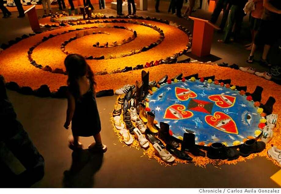 """MUERTOS23_002_CAG.JPG  Alexandra Regan, 3, of Hayward, walks past the Labyrinth by artist Calixto Robles at the Oakland Museum of California on Sunday, October 22, 2006. The Oakland Museum of California celebrates Days of the Dead, the Mexican tradition of honoring dead loved ones and ancestors with """"Laughing Bones/Weeping Hearts: Dia De Los Muertos 2006"""". The event will be the highlight of the exhibition, and Sunday's festivities included craft activities, food, music dance performance and more.  Photo by Carlos Avila Gonzalez/The San Francisco Chronicle  Photo taken on 10/22/06, in Oakland, Ca, USA  **All names cq (source) Photo: Carlos Avila Gonzalez"""