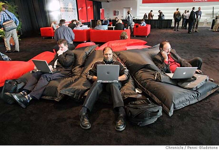 oracle  On these comfy pillows, are at left, from Oracle is David Hancock, Dhiren Patel from Semantic in Mountain View, at rt is, Joe Ammons from Georgia with Bennett International  Event on 10/23/06 in San Francisco.  Penni Gladstone / The Chronicle Photo: Penni Gladstone
