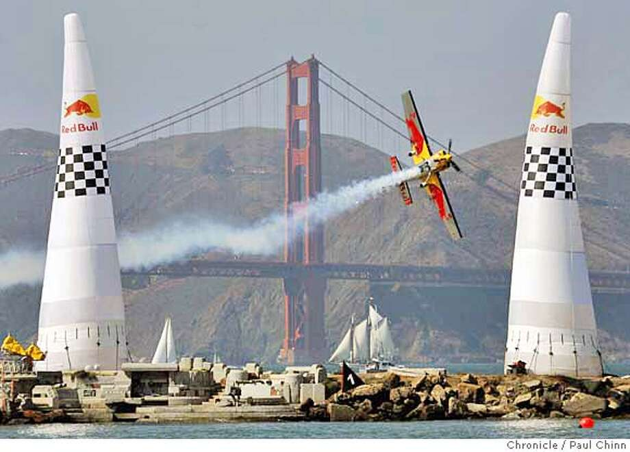 Kirby Chambliss pilots his race plane through the starting gate of the Red Bull Air Race, one of the featured events of the Fleetweek celebration in San Francisco, Calif. on Saturday, Oct. 7, 2006. Chambliss' combined time of 2:39.83 was fast enough for him to win the event.  PAUL CHINN/The Chronicle  **Kirby Chambliss Photo: PAUL CHINN