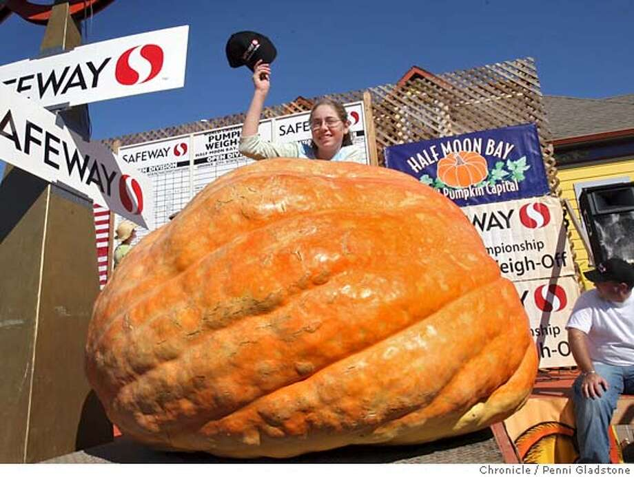 "PUMPKIN  12 yr old Amanda Zunino from Los Altos with her pumpkin, which is 4' 2"" tall, 13' 3"" circumfrence with a weight is 1191 lbs at The annual giant pumpkin growing world championships in Half Moon Bay. Event on 10/10/06 in Half Moon Bay.  Penni Gladstone / The Chronicle MANDATORY CREDIT FOR PHOTOG AND SF CHRONICLE/ -MAGS OUT Photo: Penni Gladstone"