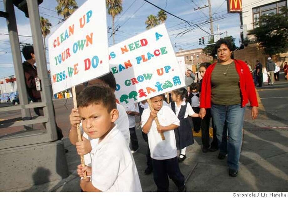 MARSHALL13_019.JPG Jonathan Rendon (front) and Miguel Gutierez (behind Rendon at right, with sign) at 16th on Mission streets. About 100 Marshall Elementary school children marched from their school at about 4:30pm to the 16th St. BART plaza as part of the Light On Afterschool program and taking back the streets.  cq--Jonathan Rendon, Miguel Gutierez  Photographed by Liz Hafalia MANDATORY CREDIT FOR PHOTOGRAPHER AND SAN FRANCISCO CHRONICLE/ -MAGS OUT Photo: Liz Hafalia