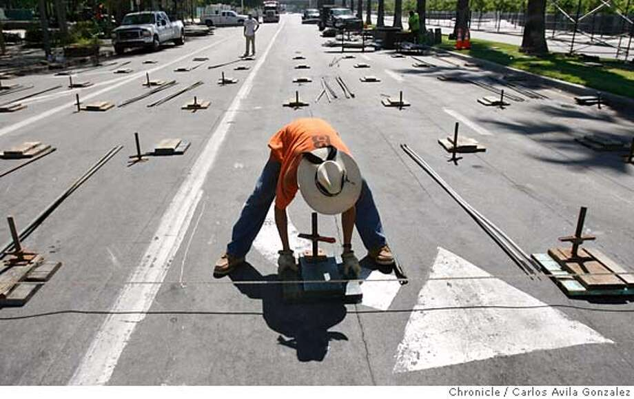 GRANDPRIX27_072_CAG.JPG  Construction workers place the footings for bleacher seatings near the route in preparation for the SAn Jose Grand Prix on Wednesday, July 26, 2006. Story about preparations for the Grand Prix in San Jose--looking for reaction from local businesses, residents, the organizers.  Photo by Carlos Avila Gonzalez/The San Francisco Chronicle  Photo taken on 7/26/06, in San Jose, Ca, USA  **All names cq (Roster) MANDATORY CREDIT FOR PHOTOG AND SAN FRANCISCO CHRONICLE/ -MAGS OUT Photo: Carlos Avila Gonzalez