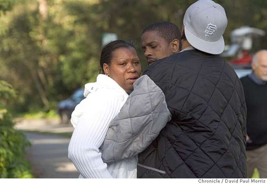 SAN FRANCISCO, CALIFORNIA - APRIL 5: Alleged family members who refused to be identified of a homicide victim was found and removed by San Francisco police officers remove a body from the Stow Lake area of Golden Gate Park on April 5, 2006 in San Francisco, California . Photo by David Paul Morris/The Chronicle Photo: David Paul Morris
