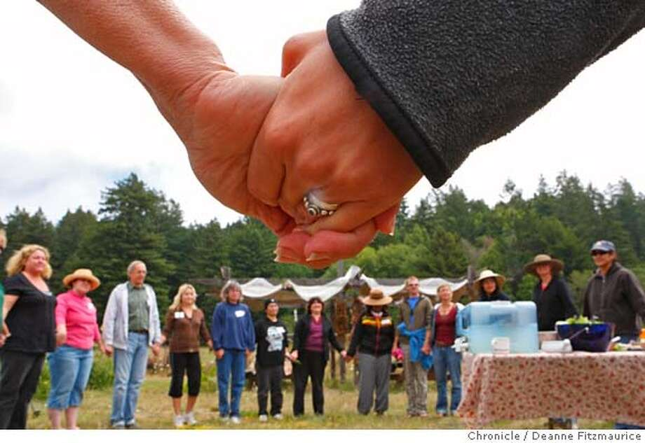 garden_0202_df.jpg  Everyone holds hands before lunch is served. Teams from six San Francisco schools gathered at Salmon Creek School in Occidental to learn about integrate gardening into their school curriculum. Photographed in Occidental on 8/2/07. Deanne Fitzmaurice / The Chronicle Mandatory credit for photographer and San Francisco Chronicle. No Sales/Magazines out. Photo: Deanne Fitzmaurice