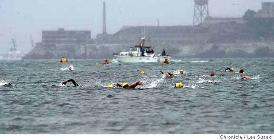 Overall of swimmers making their way to the East Beach of Crissy Field during the 1.5 mile swim of the Alcatraz Challenge on Sunday morning. The swim is followed by a run to the vista look-out just north of the Golden Gate Bridge then back. Photo taken on 080507 in San Francisco, CA.  Photo by Lea Suzuki/ The Chronicle  ()cq Photo: Lea Suzuki