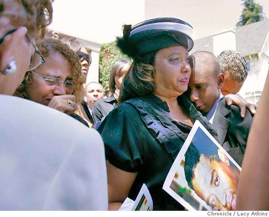 Chauncy III, right is held by his mother ( no one could tell me her name) as they follow the casket out of the St. Benedict's Catholic Church for the funeral service of Oakland Post Editor Chauncy , Wed. Aug. 8, 2007, in Oakland, Ca. (Lacy Atkins /San Francisco Chronicle) Photo: Lacy Atkins