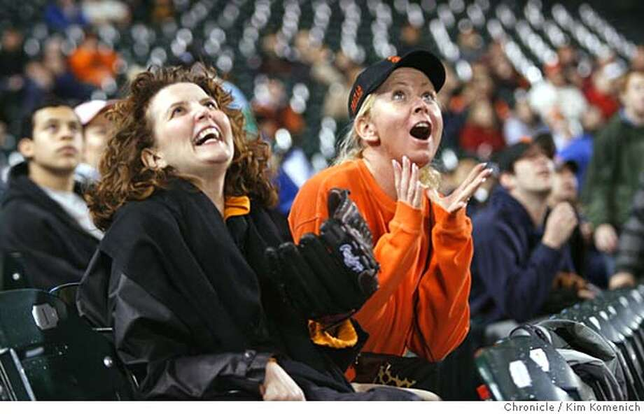 GIANTS31_125_KK.JPG  Hanne Cancian (cq all), L and Cara Heagy, both of San Francisco, react to a second inning fly out that was hit to their section by Giant Pedro Feliz in the second inning.  Fan reaction from the Giants preseason game against the Angels at SBC Park.  San Francisco Chronicle photo by Kim Komenich  3/30/06 �2006, Kim Komenich/The San Francisco Chronicle Photo: Kim Komenich
