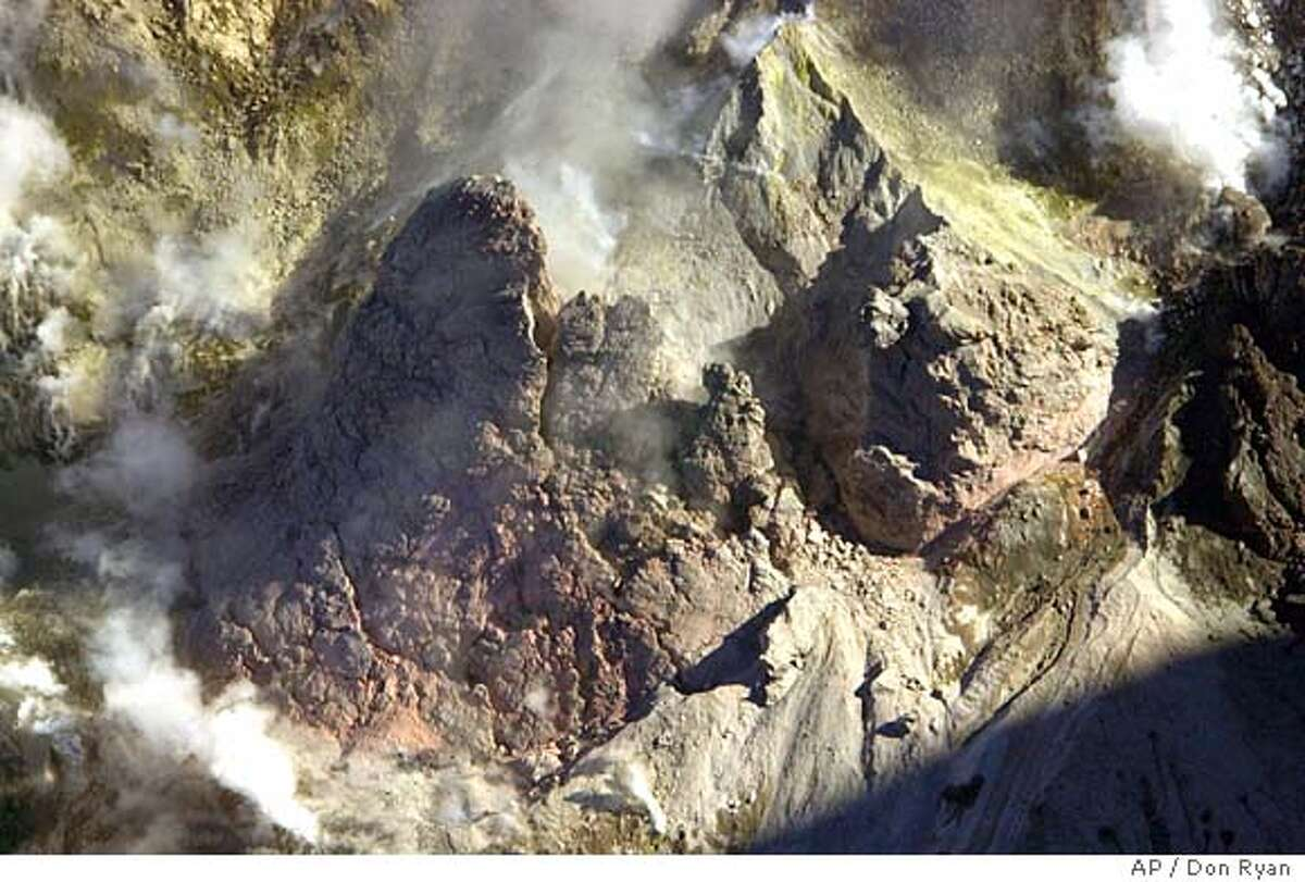 New growth shows tinges of red and green in the Mount St. Helens crater as magma continues to push to the surface where it becomes lava in southwest Washington Thursday, Oct. 14, 2004. (AP Photo/Don Ryan)