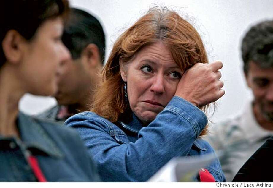 Kimberley Tatum wipes her tears after saying the pledge of allegiance for the first time as a US citizen at the ceremony, July 3, 2006, in aboard the USS Hornet in Alameda, Ca. Kimberley Tatum from Canada, is one of the 86 immigrants who were naturalized as U.S. citizens, Monday July 3, 2006, at a ceremony on board the USS Hornet in Alameda, Ca. (Lacy Atkins/The Chronicle) MANDATORY CREDITFOR PHOTGRAPHER AND SAN FRANCISCO CHRONICLE/ -MAGS OUT Photo: Lacy Atkins