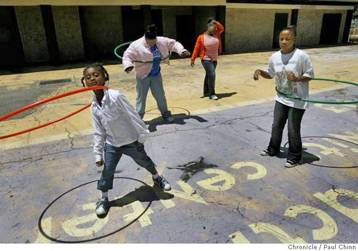 From left, Hannah Rolling, LaToshia Green, Marquita Griffin, and Patrice Starks play at the Shields-Reid Community Center in Richmond, Calif. on Wednesday, July 5, 2006 about a half mile from the site where the Neptune Society plans on relocating one of its largest crematoriums. Neighbors are concerned about possible high levels of mercury emitted into the air from burning dental fillings of the deceased. PAUL CHINN/The Chronicle **Hannah Rolling, LaToshia Green, Marquita Griffin, Patrice Starks MANDATORY CREDIT FOR PHOTOGRAPHER AND S.F. CHRONICLE/ - MAGS OUT