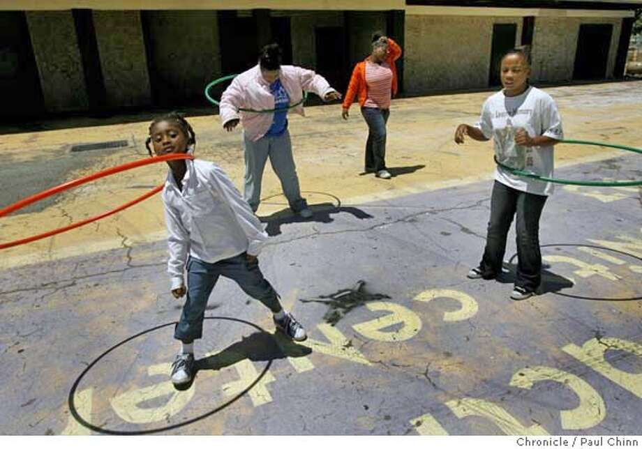 From left, Hannah Rolling, LaToshia Green, Marquita Griffin, and Patrice Starks play at the Shields-Reid Community Center in Richmond, Calif. on Wednesday, July 5, 2006 about a half mile from the site where the Neptune Society plans on relocating one of its largest crematoriums. Neighbors are concerned about possible high levels of mercury emitted into the air from burning dental fillings of the deceased.  PAUL CHINN/The Chronicle  **Hannah Rolling, LaToshia Green, Marquita Griffin, Patrice Starks MANDATORY CREDIT FOR PHOTOGRAPHER AND S.F. CHRONICLE/ - MAGS OUT Photo: PAUL CHINN