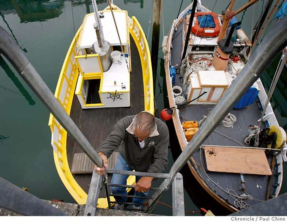 """Sal Alioto descends a ladder to his Monterey fishing boat """"Golden Gate"""" (left) for a day of fishing on the bay at Fisherman's Wharf in San Francisco, Calif. on Saturday, July 1, 2006. Owners of the historic fishing boats are banding together in an effort to save the aging fleet. The Port Commission recently raised slip fees for the Monterey boats 175% compared to only a 60% hike for commercial boats, according Alioto.  PAUL CHINN/The Chronicle  **Sal Alioto MANDATORY CREDIT FOR PHOTOGRAPHER AND S.F. CHRONICLE/ - MAGS OUT Photo: PAUL CHINN"""