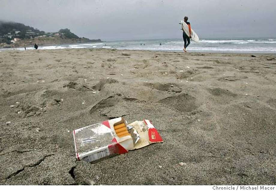 smokingban_011_mac.jpg A water-logging pack of smokes, covered with sand, lies on the Linda Mar Beach in Pacific. Pacifica, Ca., Looks like it may join a growing number of communities that are banning smoking on their public beaches. Event in, Pacifica, Ca, on 7/1/06. Photo by: Michael Macor / San Francisco Chronicle Mandatory credit for Photographer and San Francisco Chronicle / Magazines Out Photo: Michael Macor