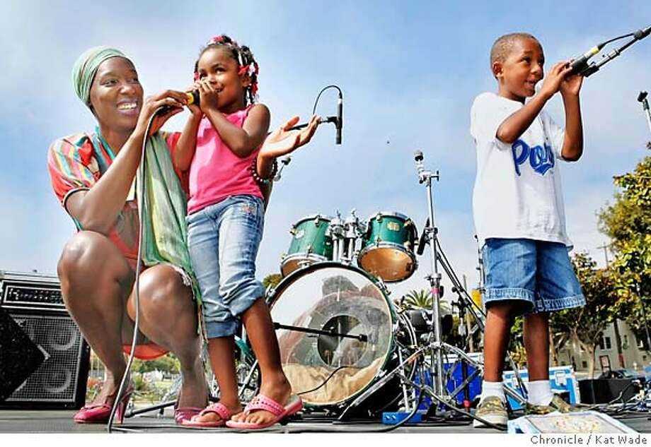 "GIRLFEST_0003_KW.JPG  On July 22, 2007 STAND ALONE : Singer Imani Uzuri from New York performs with assistance from some local children (L to R) Diamond Hodges, 6, and Devosia Harper, 6, during the final event, a free concert in Delores Park, for the 2nd Annual GiRL FeST Bay Area, ""preventing violence against women and girls through education and Art"" in San Francisco's North Beach. Kat Wade/The Chronicle  Imani Uzuri, Jade Mar, 7, and Diamond Hodges(CQ, subject) Mandatory Credit for San Francisco Chronicle and photographer, Kat Wade, No Sales Mags out Photo: Kat Wade"