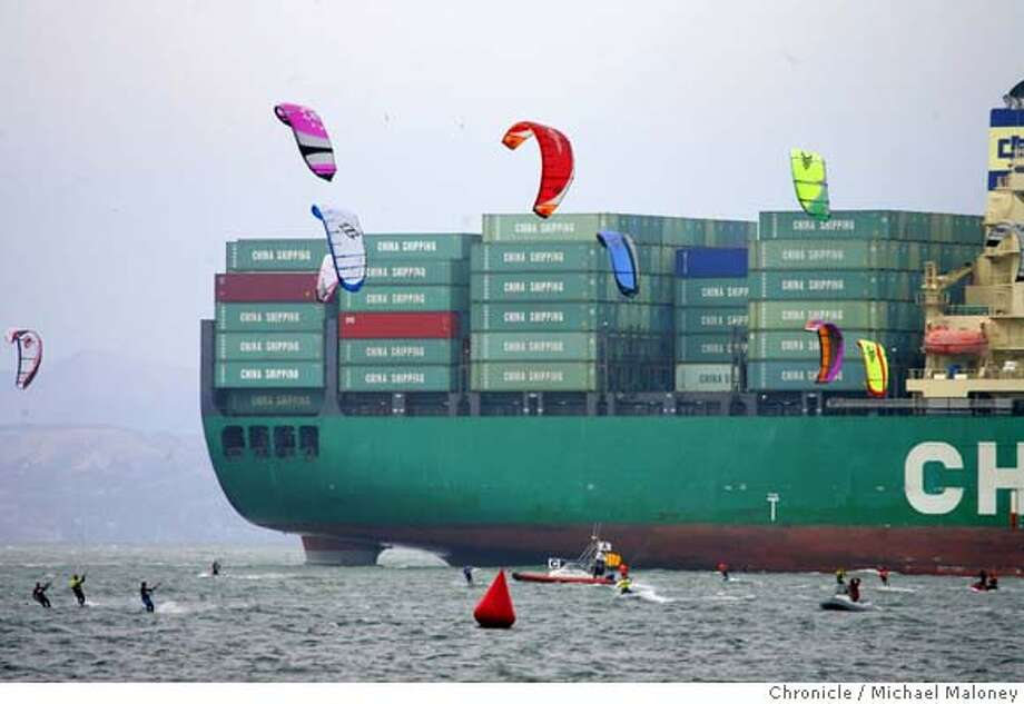 The giant shipping container ship CSCL Los Angeles heads to a San Francisco pier dwarfing a kite boarding competition off the Marina Green in San Francisco, CA this afternoon. The ship is owned by China Shipping Container Lines (CSCL)  Photo taken on 7/25/07 in San Francisco, CA  Photo by Michael Maloney / San Francisco Chronicle MANDATORY CREDIT FOR PHOTOG AND SF CHRONICLE/NO SALES-MAGS OUT Photo: Michael Maloney